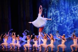 Little Snowflakes perform on stage through the Dance with Us program